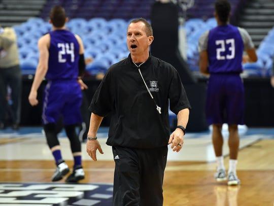 Weber State coach Randy Rahe coaches his team during