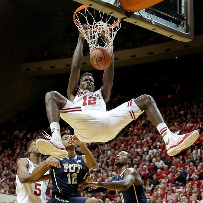 Indiana forward Hanner Mosquera-Perea (12) dunks the ball over Pittsburgh's Chris Jones (12) Dec. 2, 2014, at Assembly Hall.
