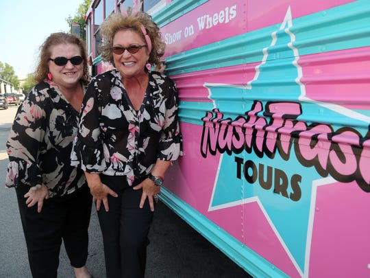 Brenda Kay and Sheri Lynn (the Jugg sisters) outside the pink bus they use for their NashTrash tours while parked in the Nashville Farmer's Market Saturday, July 22, 2017.