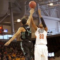 Bowling Green's Richaun Holmes (22) puts up a 3-point field goal over Ohio's Ryan Taylor (14). Holmes finished the game against Miami with 15 points and eight rebounds.