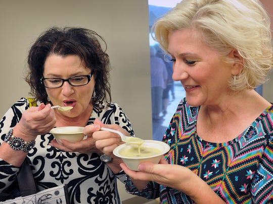Judy Kurani, left, and Lisa Pettijohn get ready to try some corn chowder from Bistro Express during the 2017 Empty Bowls event at the Wichita Falls Museum of Art at Midwestern State University. Empty Bowls is a fundraiser for the Wichita Falls Area Food Bank.