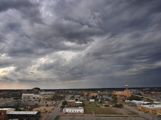 In this 2018 file photo, skies darkened as storms moved into the North Texas area from the southwest.  North Texas will remain in a high wind warning through early Thursday morning, with damaging wind gusts that could reach near 60 mph.