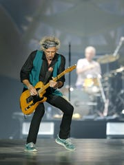 """Rolling Stones' Keith Richards takes center stage during their """"Zip Code"""" tour at Ralph Wilson Stadium in Buffalo on Saturday."""