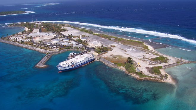 Delta Mariner docks at Meck Island, part of the Kwajalein Atoll in the Republic of the Marshall Islands, with support equipment for use in the Missile Defense Agency's two-stage intermediate/long-range launch vehicle program.