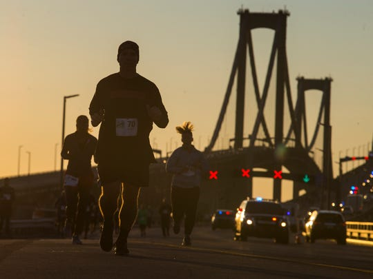 Runners make their way into Delaware from New Jersey during the Delaware Memorial Bridge 5k Run to Acceptance for Special Olympics early Sunday morning.