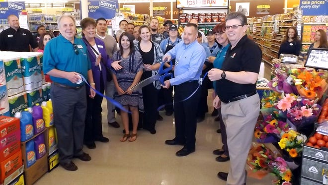 Albertsons in Silver City had a Grand Re-Opening and Ribbon Cutting on Wednesday to celebrate the completion of the remodeling project for the store. Albertsons invested approximately $500,000 on the project. Store Director Darrel Britton cut the ribbon while customers, Silver City/Grant County Chamber of Commerce members, Albertsons employees and staff from the company's district office watched the festivities.