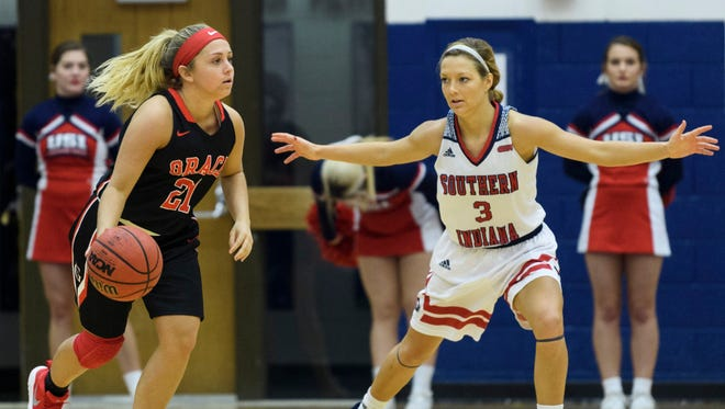 USI's Randa Harshbarger (3) guards Grace's Brooke Sugg (21) at USI's Physical Activites Center in Evansville, Ind., Sunday, Dec. 31, 2017.