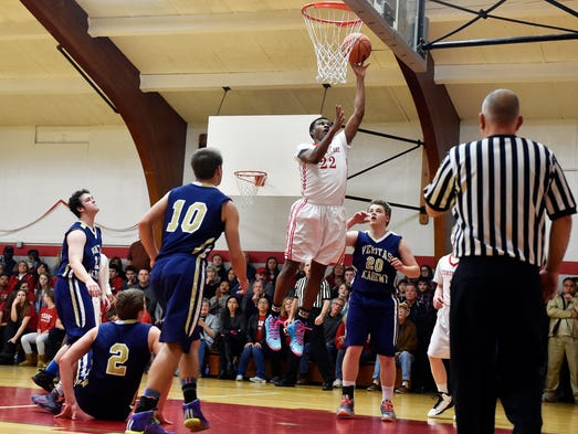 York Country Day's DeAireus Brown shoots during the