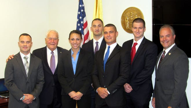 Toms River Mayor Thomas F. Kelaher swore in five new police officers at the Oct. 11 Township Council meeting. Pictured are (left to right) Officer Scott Devecka, Kelaher, Officers Rebecca Sayegh, James Manolio, Joseph Baldasare, James Colline and Police Chief Mitchell Little.