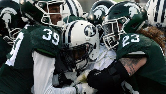 BYU running back Squally Canada carries a host of Spartan
