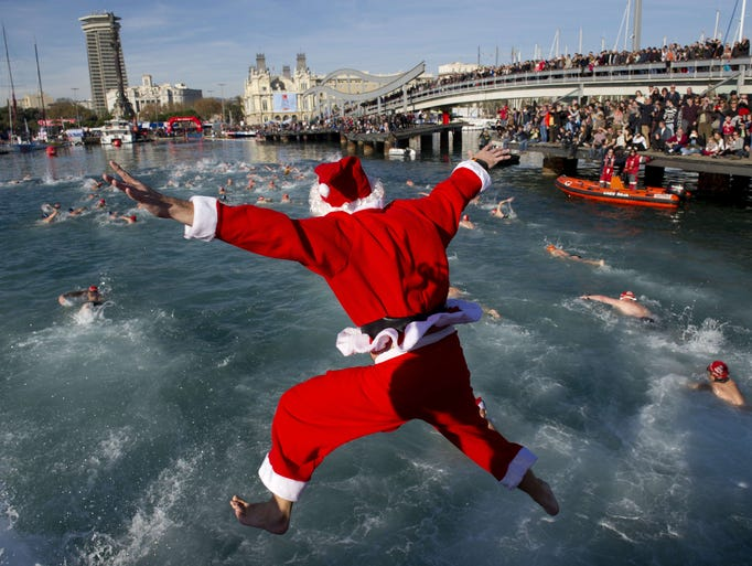 A participant wearing a Santa Clause costume jumps