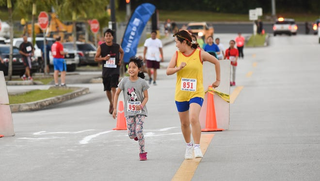Some runners decided to sprint the last stretch to the finish line during the Antonio B. Won Pat International Airport Authority 5K at Home Depot in Tamuning on Jan 9.
