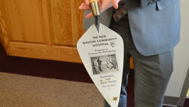 Andrew O'Connor holds the original trowel used to break ground on Galion Community Hospital in 1974. The trowel was donated by members of the Wires family.