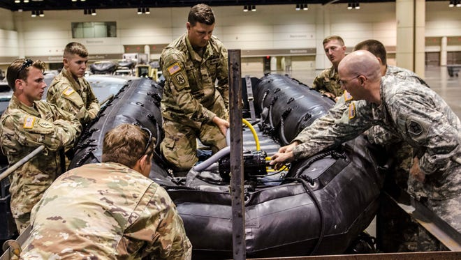 A group of Soldiers with the Florida National Guard's Chemical Biological Radiological Nuclear Emergency Response Force-Package inflate a zodiac boat used in the rescue operations of civilians during disasters such as Hurricane Irma. The CERF-P joins the Florida Fish and Wildlife Conservation Commission and the New York State Division of Homeland Security & Emergency Services and Urban Search and Rescue at a staging in Orlando while they await reconnaissance and rescue missions.