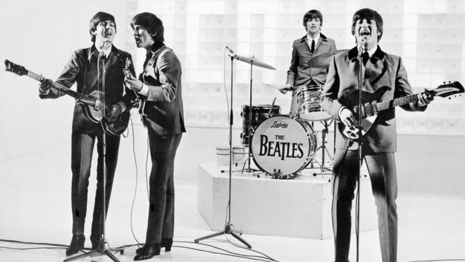 """The Beatles in a scene from """"A Hard Day's Night."""""""