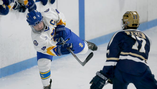 Irondequoit's Phillip Barilla shoots against Notre Dame/Batavia in the second period of the Eagles 4-3 win, December 23 at Lakeshore Hockey Arena.