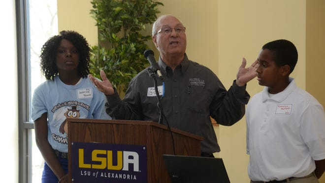 Pineville Youth Center director Alvarez Peychaud (center) talks about the programs the center offers and two youngsters, Jasmine Bowie (left) and Kameron Mattock (right) who are both members of the center.  LSUA hosted the United Way of Central Louisiana along with other partners for a summit on concerning after school programs.-Melinda Martinez/The Town Talk