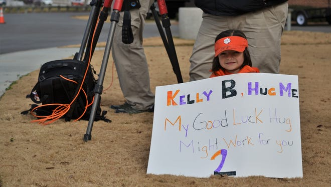 Eight-year-old Savana Jones, of Westminster, waits for Clemson quarterback Kelly Bryant to walk by and give her a good-luck hug on Dec. 27, 2017.
