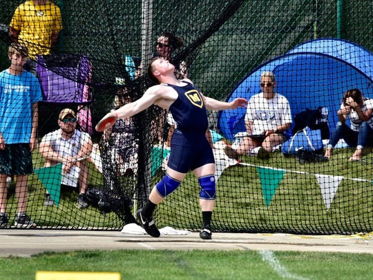 Ryan Smith gives the discus a twirl