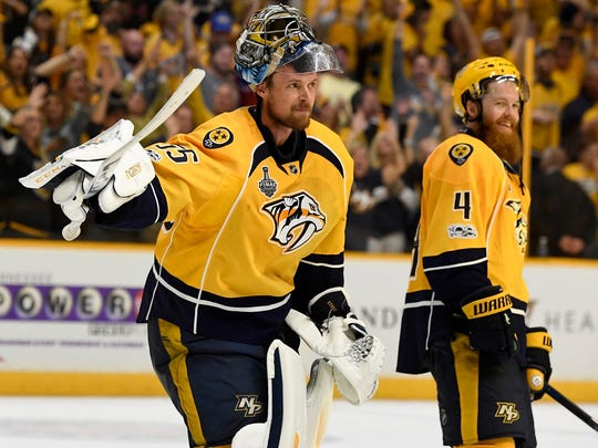 Nashville Predators goalie Pekka Rinne (35) lifts his