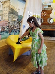 Willow Scott, 7, christens a dinghy donated by SEAS