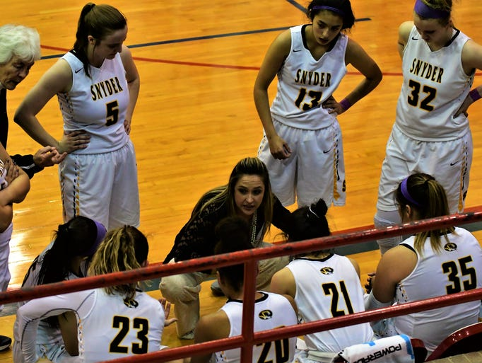 Snyder coach T'Leah Eicke speaks with her team during