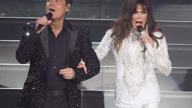 This Aug. 22, 2017 file photo shows Donny Osmond, left, and Marie Osmond performing at the Santander Arena in Reading, Pa. Donny and Marie Osmond say they will end their Las Vegas show later this year, concluding an 11-year run on the Strip.