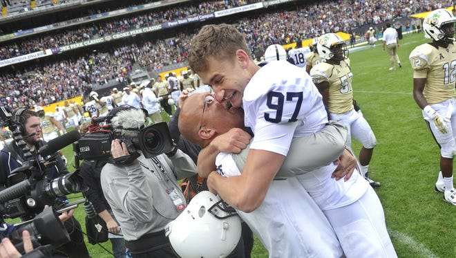 Sam Ficken, right, experienced tough and tremendous times at Penn State. He won the Croke Park Classic on the final play in Ireland.
