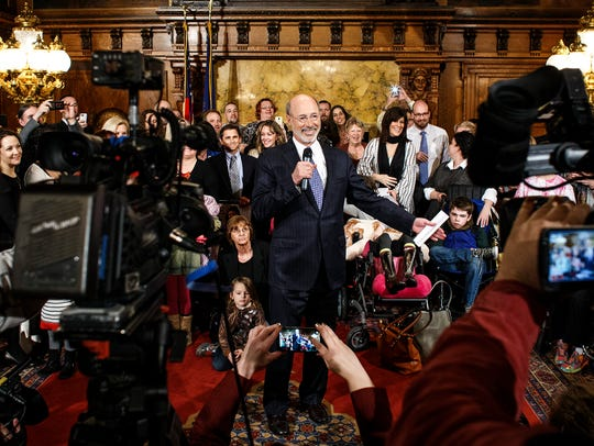 In this file photo, Gov. Tom Wolf meets with advocates  for medical marijuana. He'd later sign a bill establishing the state's Medical Marijuana Program.