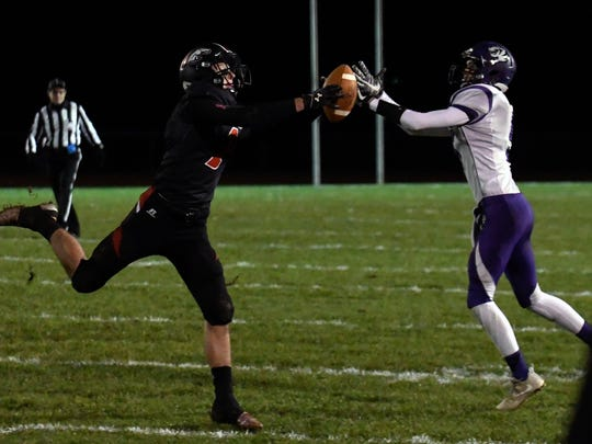 Bellevue's Carson Betz (1) intercepts a pass early in the first quarter of play against Lawrence on Friday night.