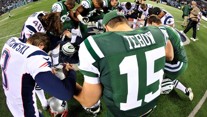 Tim Tebow created a brouhaha by kneeling in the end zone in 2012. He joined a post-game prayer circle that same year here.