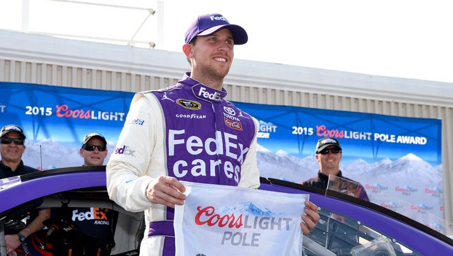 Denny Hamlin celebrates Friday after winning his third pole in the last six races at Dover International Speedway.