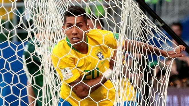 Roberto Firmino of Brazil reacts after scoring the 2-0 goal during the FIFA World Cup 2018 round of 16 soccer match between Brazil and Mexico in Samara, Russia.