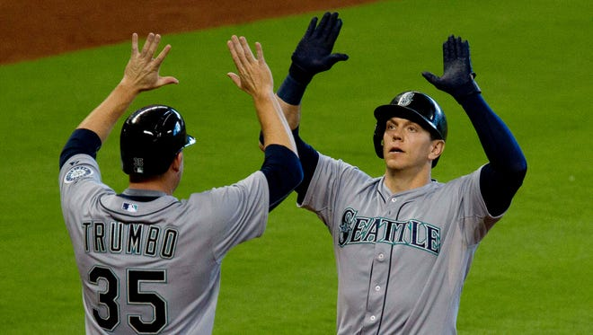 Seattle Mariners' Logan Morrison celebrates with teammate Mark Trumbo after hitting his second home run of a baseball game against the Houston Astros during the third inning Saturday, June 13, 2015.