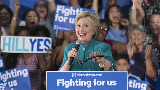 Presidential candidate Hillary Clinton speaks to supporters gathered Saturday evening at the Edison High School gym in Fresno.