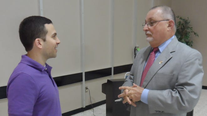 Rapides Parish Coliseum Executive Director Richard Karamatic (right) talks with LSUA basketball coach Larry Cordaro before Karamatic spoke to the Alexandria Rotary Club on Tuesday.