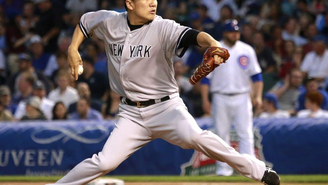 New York Yankees starting pitcher Masahiro Tanaka delivers during the first inning against the Chicago Cubs on Tuesday at Wrigley Field in Chicago.