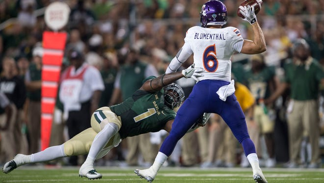 Northwestern State Demons quarterback Joel Blumenthal (6) is pressured by Baylor Bears linebacker Taylor Young (1) during the second quarter at McLane Stadium.