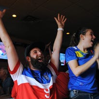 U.S. Soccer fans, Justin Vanden Bosch, left, and Irene Samaniego, both of Sioux Falls, cheer after the U.S. scored their fourth goal while watching the 2015 FIFA Women's World Cup Final between the U.S. and Japan on Sunday, July 5, 2015, at the Gateway Casino and Lounge in Sioux Falls.