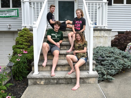 The Fitzgerald quadruplets from Woodland Park are shown at home on July 1. Clockwise from upper right, they are Nicole, Lauren, Alexa and Zachary.