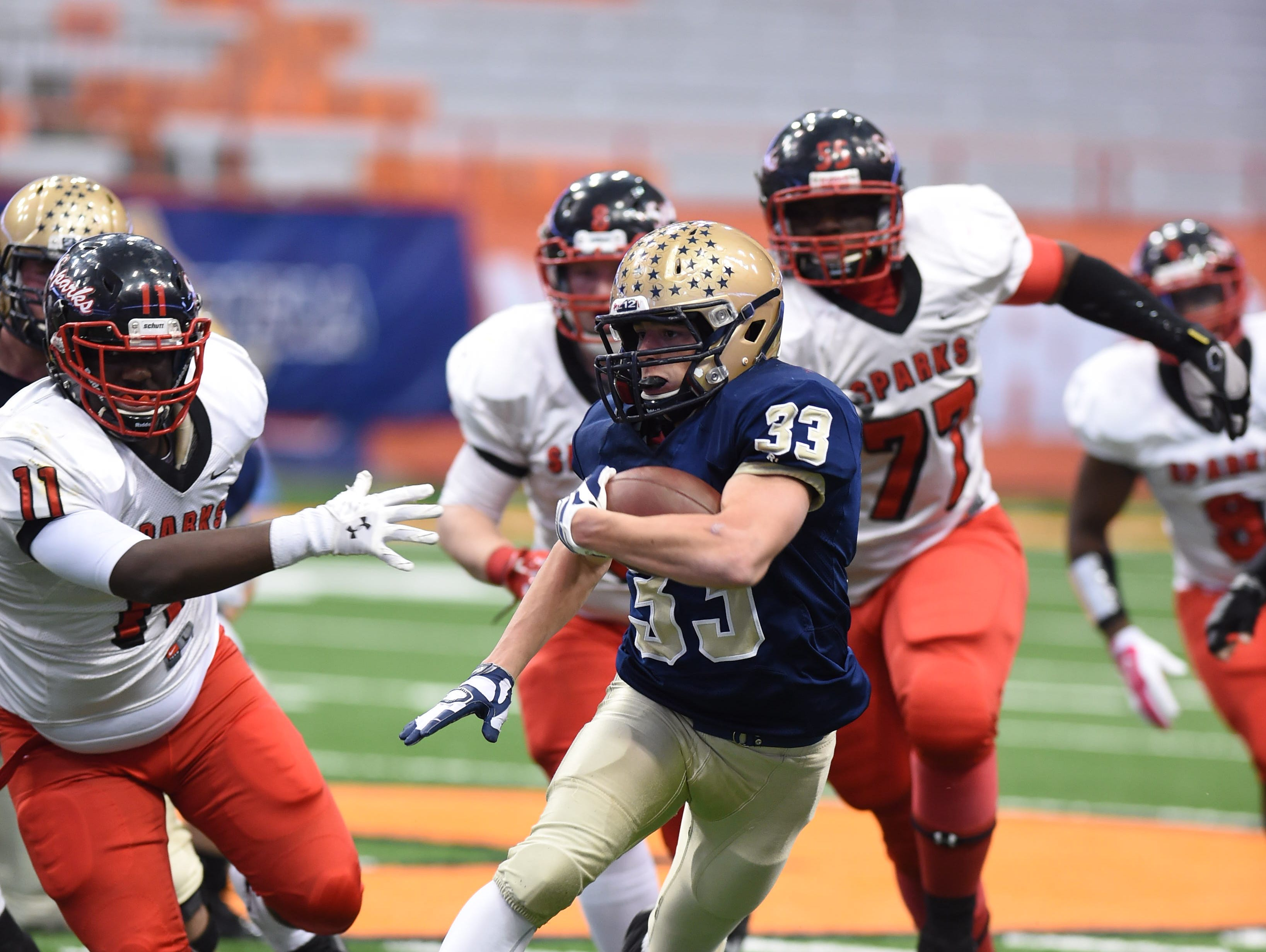 Lourdes' Christopher Salotto carries the ball through the South Park defense during the New York State Championship final in Syracuse on Friday.