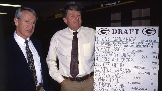 Green Bay Packers coach Lindy Infante, left, and executive vice president of football operations Tom Braatz stand next to a chart showing the team's draft picks on April 24, 1989. They're in the Packers' locker room at Lambeau Field.