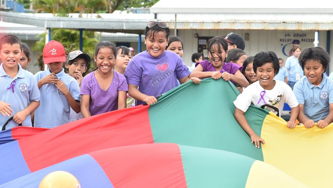 "Marcial Sablan Elementary School in Agat celebrated Relay Recess on Wednesday, June 3. The school raised $1130.32, nearly triple its goal of $400, toward the American Cancer Society's fundraiser, according to Principal Geraldine Pablo. The school ""took on the challenge"" because ""in one way or another, someone is affected by cancer,"" said teacher Mayann Charfauros, who coordinated the efforts along with teacher Charlene Loboton. The fundraising period was extended due to Typhoon Dolphin, she said. ""It's not your size or height,"" Charfauros said of the lesson students learned through the program. ""It's about (the size of) your heart."""