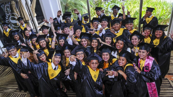 Graduating seniors of Tiyan High School's Class of 2015 pose for a photo before their commencement exercise at the Sheraton Laguna Guam Resort in Tamuning on June 11.