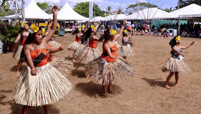 Cultural art: Guma Inian I Saina-Ta dancers entertain the crowd at the 27th annual Guam Micronesia Island Fair at the Ypao Beach Park in April of last year.
