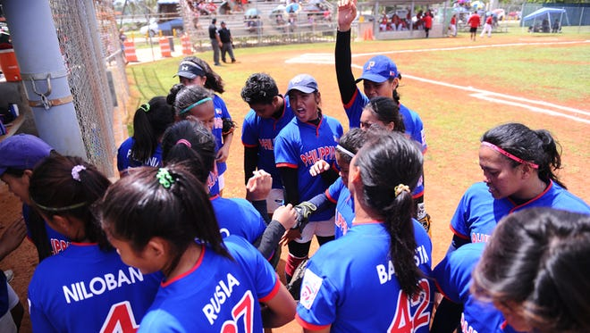 Team Philippines rallies for a cheer between  innnings during the Asia Pacific Little League Girls' Fast-pitch Softball Regional Tournament game: Big League Division game against Team Guam at the Guerrero Stadium in Hagatna on June 12.Rick Cruz/Pacific Daily News/rmcruz@guampdn.com