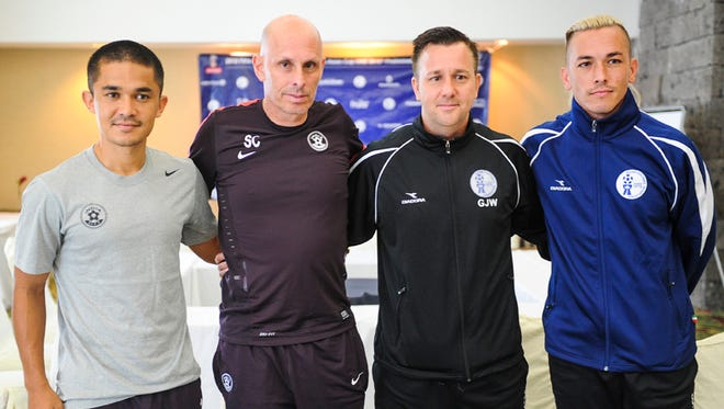 The captains and their coaches of the Guam and India FIFA World Cup teams pose for a photo after a press conference at the Pacific Star Hotel in Tumon on June 15. From left: Sunil Chhetri, India team captain; Stephen Constantine, India head coach; Gary White, Guam head coach and Jason Conliffe, Guam team captain. Both teams are scheduled to compete against each other in the India FIFA World Cup Qualifier game at the Guam Football Association National Training Center on June 16.