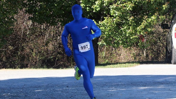 """Oskar Blue"" competes in the Oskar Blues Brewery 4-miler on Nov. 14, the last in the inaugural Race to the Taps series. He won the King of the Taps spirit award."