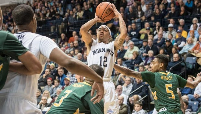 Monmouth guard Justin Robinson drains a shot last week in front of a sellout crowd for the Hawks game against Siena.