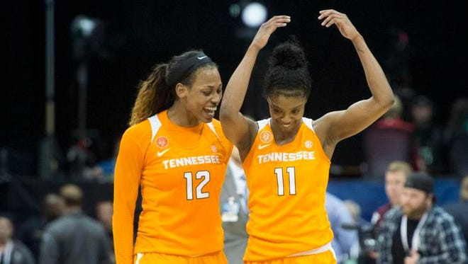 Tennessee's Bashaara Graves, left, and Diamond DeShields celebrate Tennessee defeated Texas A&M 70-60 during an NCAA college basketball game in the Southeastern Conference women's tournament in Jacksonville, Fla., on Friday, March 4, 2016.